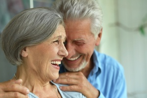 older couple at home laughing