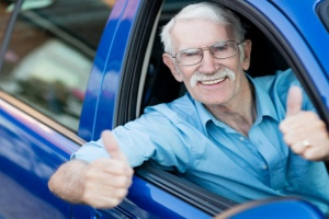 old man happy in a car that was a women getting in car for a Vehicle Donation