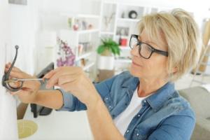 Senior Woman Doing Minor Home Repairs