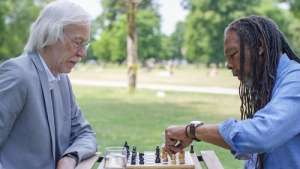 Two Seniors Playing Chess with Friendly Visitor Program