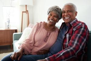 loving senior couple smiling for the camera