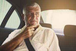 senior man in back of a senior transportation