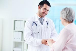 elderly women talking to doctor about Senior Medical Transportation
