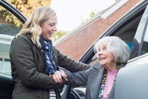 female driver helping women in a Senior Transportation