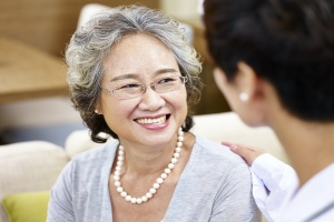 elderly woman happy with her Senior Medical Transportation