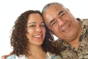 father and daughter smiling who is Caring For Aging Parents