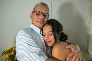 daughter and father hugging while they are Caring For The Elderly