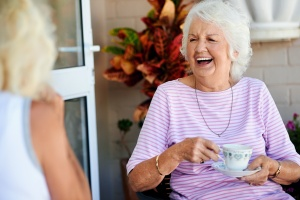women laughing while she is Aging In Place