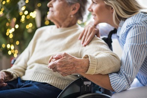senior woman in wheelchair with a health visitor at her Senior Care Options