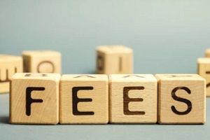 fees word written in wooden box for Senior Transportation Service